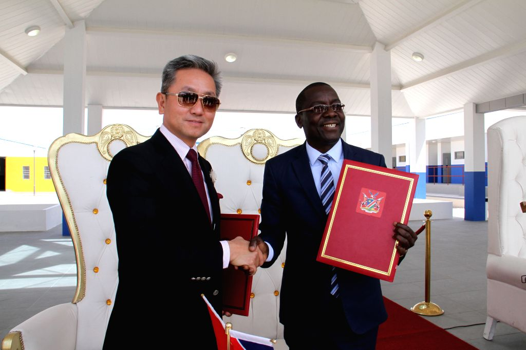 REINFONTEIN, Sept. 13, 2019 - Chinese Ambassador to Namibia Zhang Yiming (L) and Namibia's Minister of Sports, Youth, and National Service Erastus Uutoni attend the handover ceremony of the ...