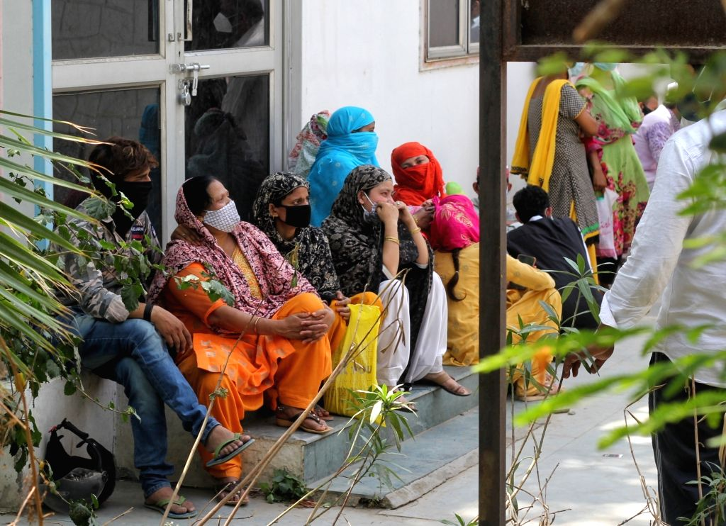 Relative of a coronavirus victim mourns outside a mortuary of a COVID-19 hospital in New Delhi On Monday, 19th 2021.