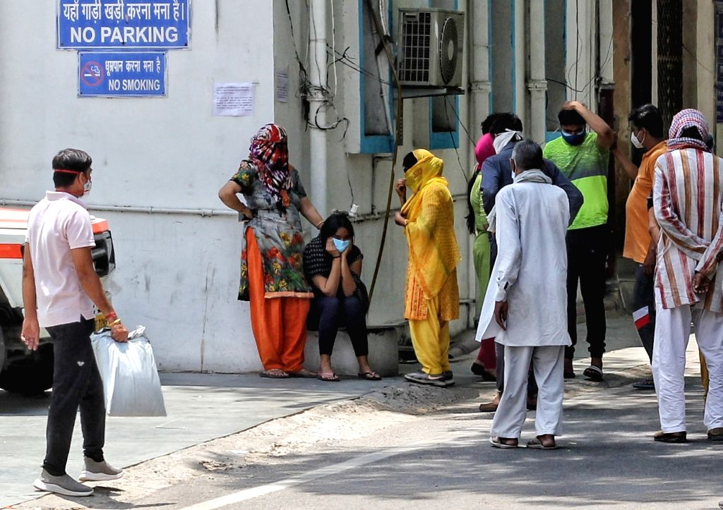 Relative of a coronavirus victim mourns outside a mortuary of a COVID-19 hospital (LNJP) in New Delhi on Tuesday 11 May, 2021.