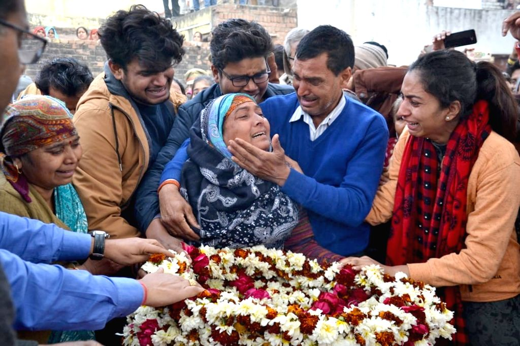 Relatives mourn as the body of CRPF soldier Kaushal Kumar Rawat who was martyred in the Pulwama terror attack, reached his native village Kahari, near Mathura on Feb. 16, 2019. - Kaushal Kumar Rawat