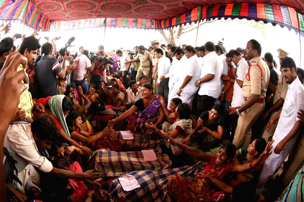Relatives mourn the death of their family members after Nine agricultural labourers were killed and 15 injured when a tractor plunged into a canal near Vaddipatla in Telangana's Nalgonda ...