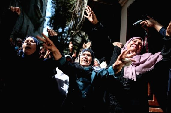 Relatives of Palestinian young man Ahmed Al-Shenbari mourn during his funeral in the northern Gaza Strip town of Beit Hanoun, May 11, 2021.