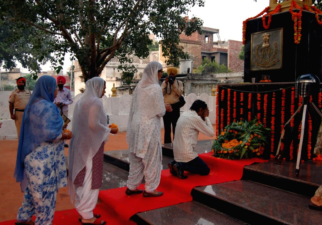 Relatives of slain martyrs attend during a programme organised to commemorate Police Commemoration Day in Amritsar on Oct 21, 2016.