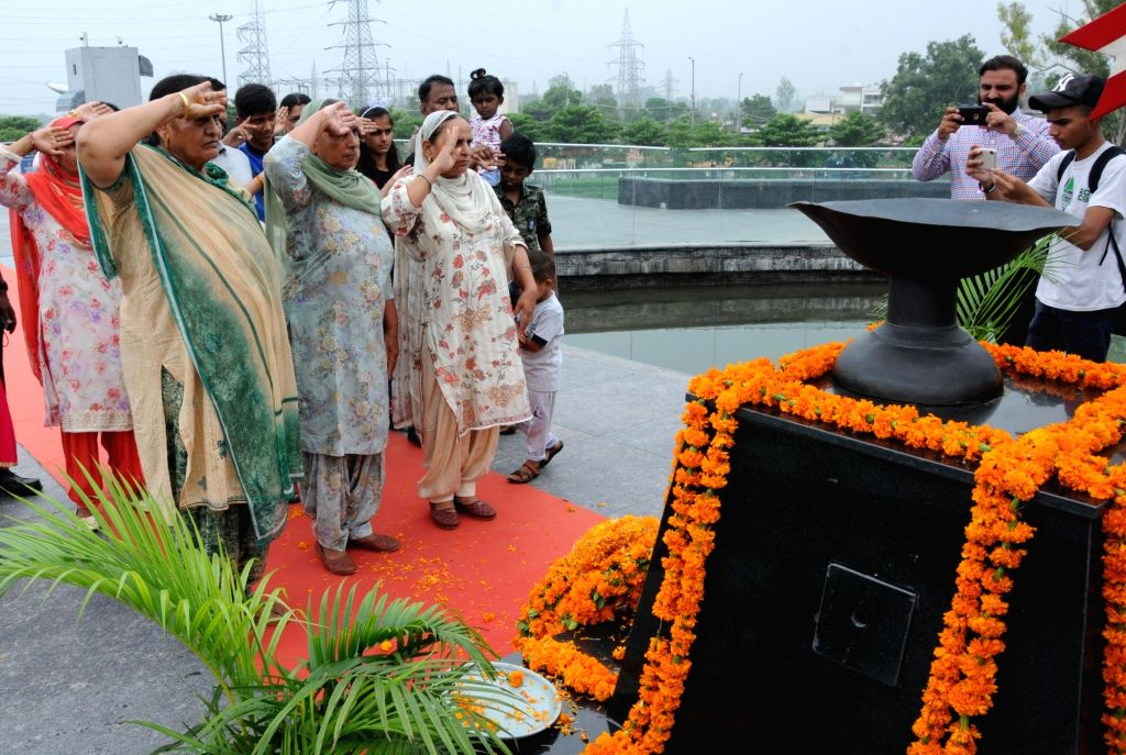 Relatives of the Indian Army soldiers martyred in the Kargil war pay tributes to the martyrs on 20th Anniversary of Kargil Vijay Diwas at the Punjab State War Heroes' Memorial and Museum, ...