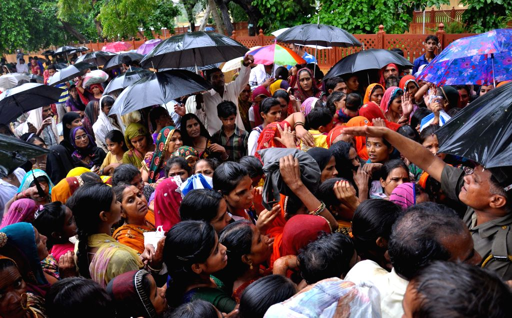 Relatives of the inmates of Jaipur Central Jail gather outside the jail premises to meet their dear ones on Raksha Bandhan in Jaipur on Aug 10, 2014.