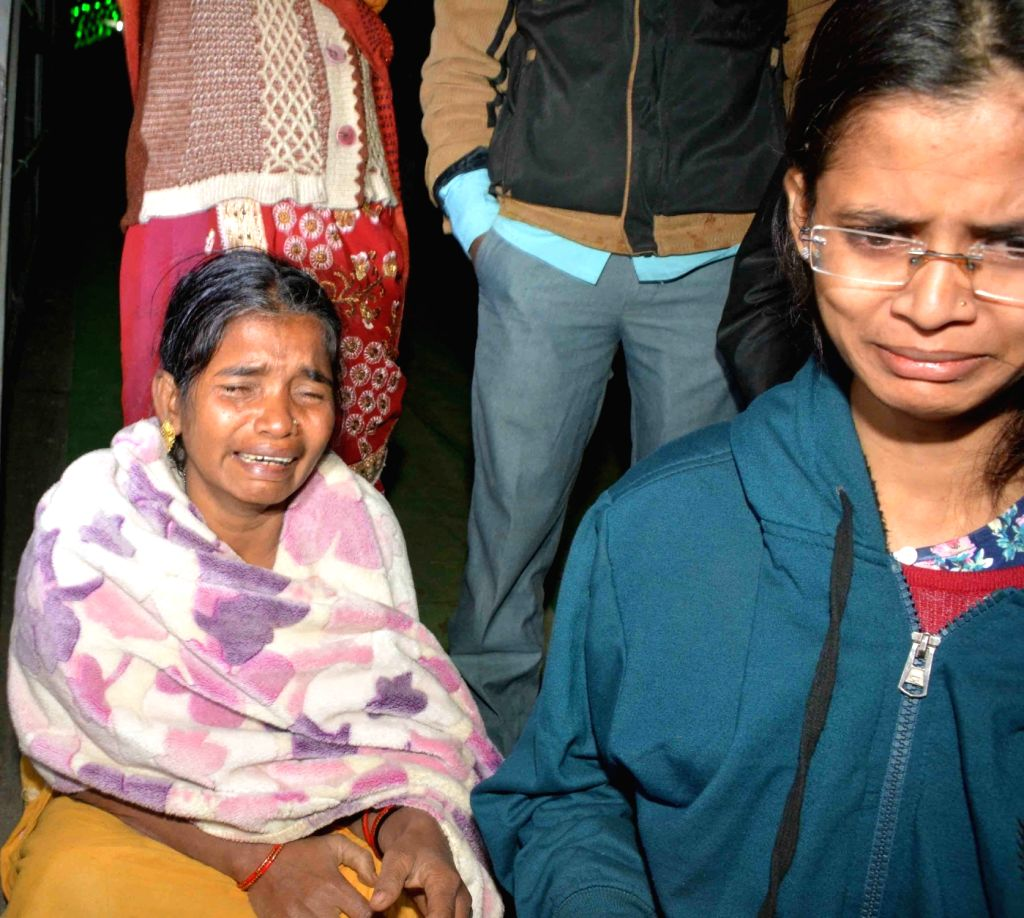 Relatives of the victims of boat accident  in Patna on Jan 14, 2017. At least 17 passengers were killed and many others were missing as a boat carrying 40 people capsized in the Ganga river ...