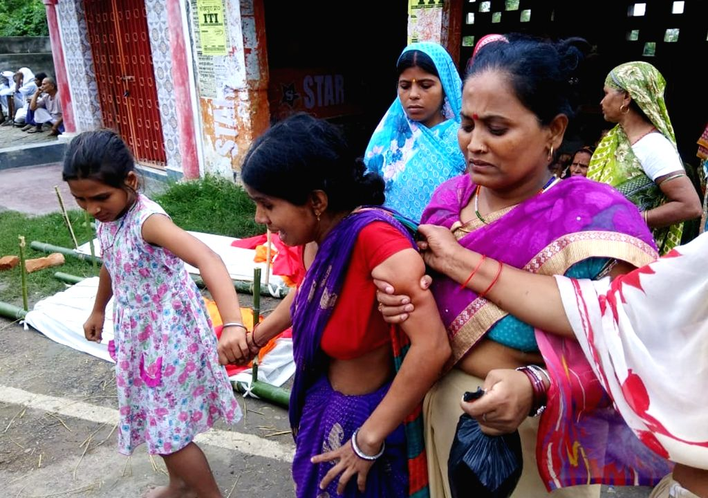 Relatives of those killed on a car accident at NH333A Bihar griefs for the lost souls, in Jamui district, Bihar, on July 27, 2018.