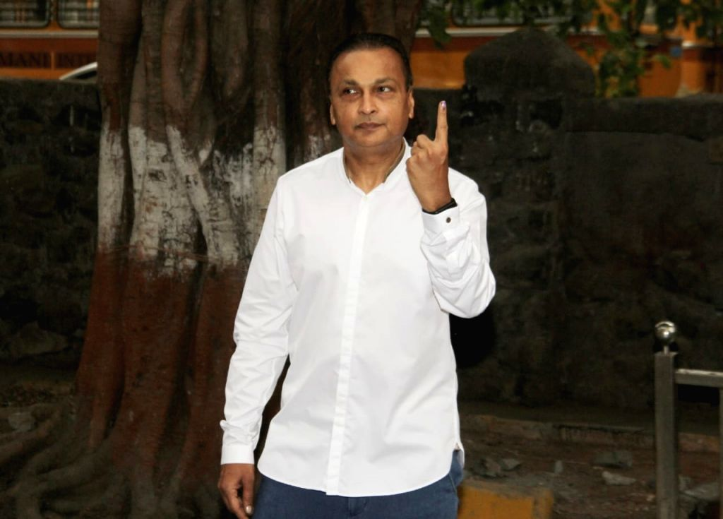Reliance ADAG Group chairman Anil Ambani shows his forefinger marked with indelible ink after casting vote during the fourth phase of 2019 Lok Sabha elections in Mumbai on April 29, 2019. - Ambani