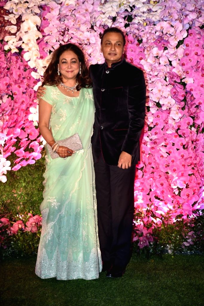 Reliance Communication (RCom) Chairman Anil Ambani along with wife Tina Ambani at the wedding reception of Akash Ambani and Shloka Mehta in Mumbai on March 10, 2019. - Tina Ambani, Akash Ambani and Shloka Mehta