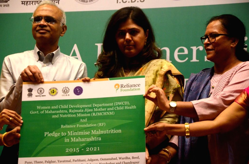 Reliance Foundation CEO Jagannatha Kumar and Maharashtra Women and Child Development Minister Pankaja Munde during the signing of a tripartite MoU between Reliance Foundation and Rajmata ... - Pankaja Munde and Kumar