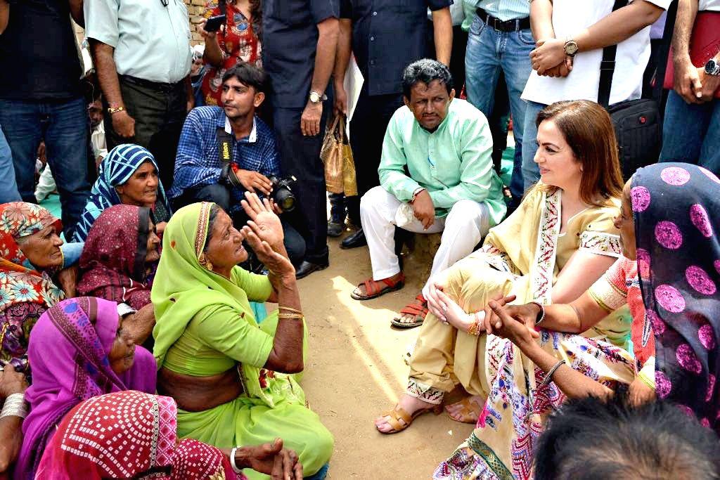 Reliance Foundation (RF) Chairperson Nita Ambani meets flood victims of Banaskantha district of Gujarat on Aug 9, 2017. - Nita Ambani