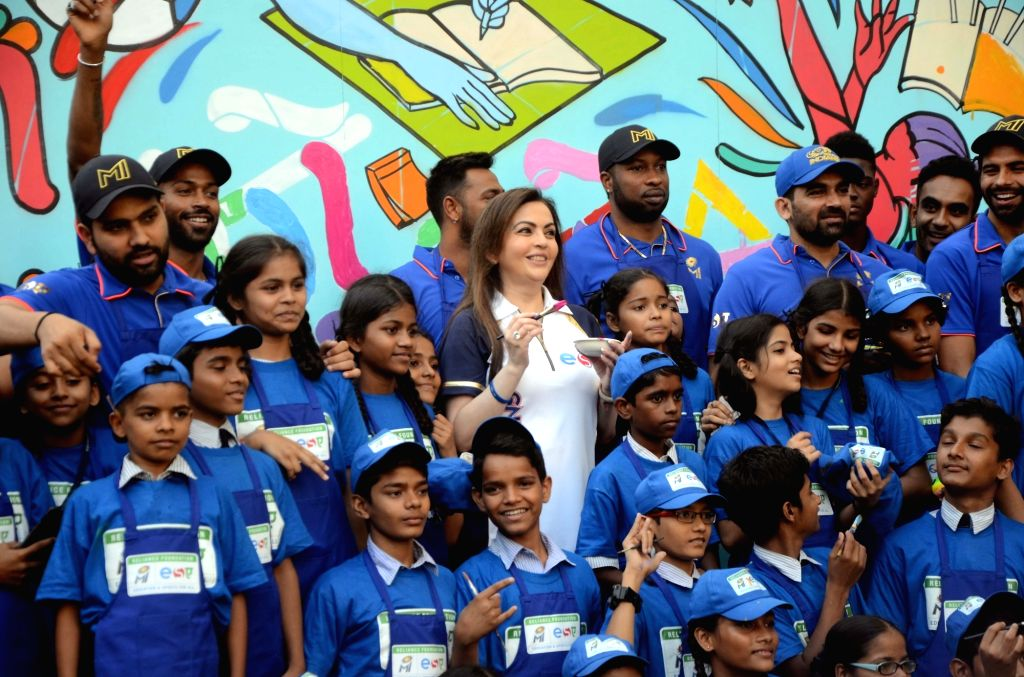Reliance Foundation's Nita Ambani with Mumbai Indians' Rohit Sharma, Kieron Pollard, Krunal Pandya, Jasprit Bumrah and Yuvraj Singh during a programme organised by Reliance Foundation under ... - Nita Ambani, Rohit Sharma and Yuvraj Singh