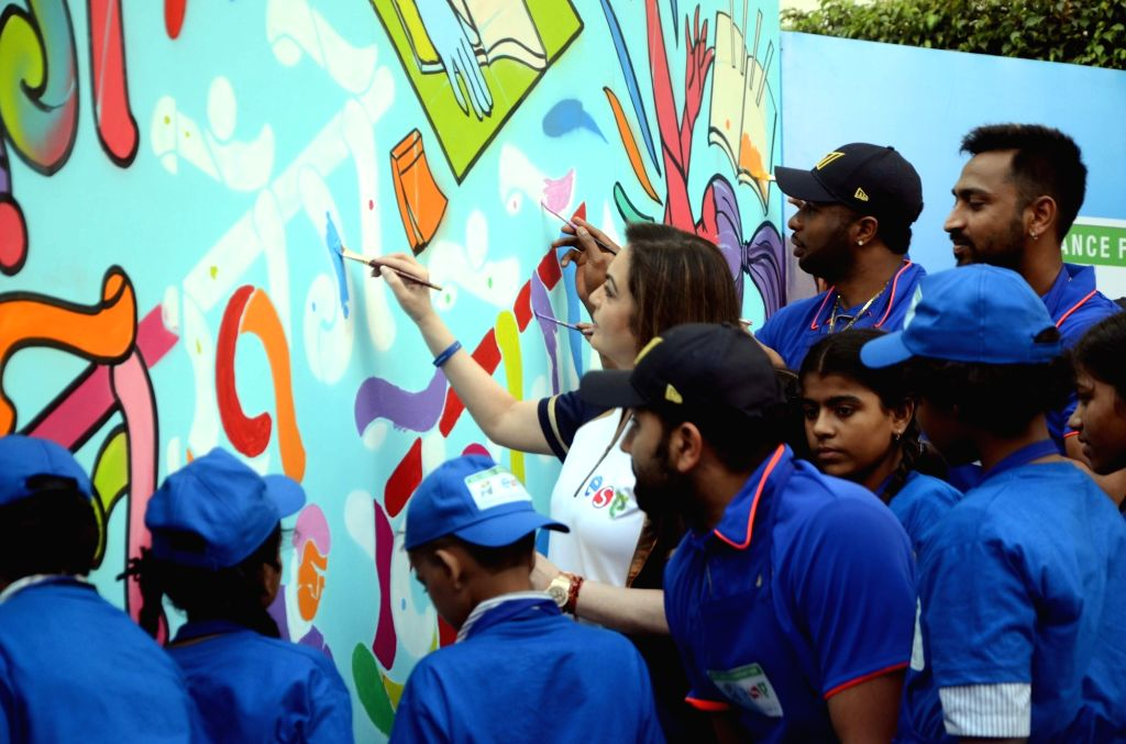 Reliance Foundation's Nita Ambani with Mumbai Indians' Rohit Sharma, Kieron Pollard and Krunal Pandya during a programme organised by Reliance Foundation under Education and Sports For All ... - Nita Ambani and Rohit Sharma