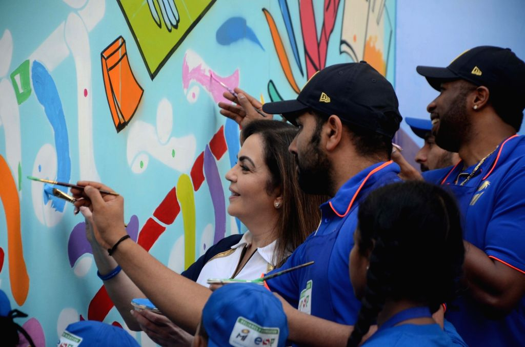 Reliance Foundation's Nita Ambani with Mumbai Indians' Rohit Sharma and Kieron Pollard during a programme organised by Reliance Foundation under Education and Sports For All (ESA) initiative ... - Nita Ambani and Rohit Sharma