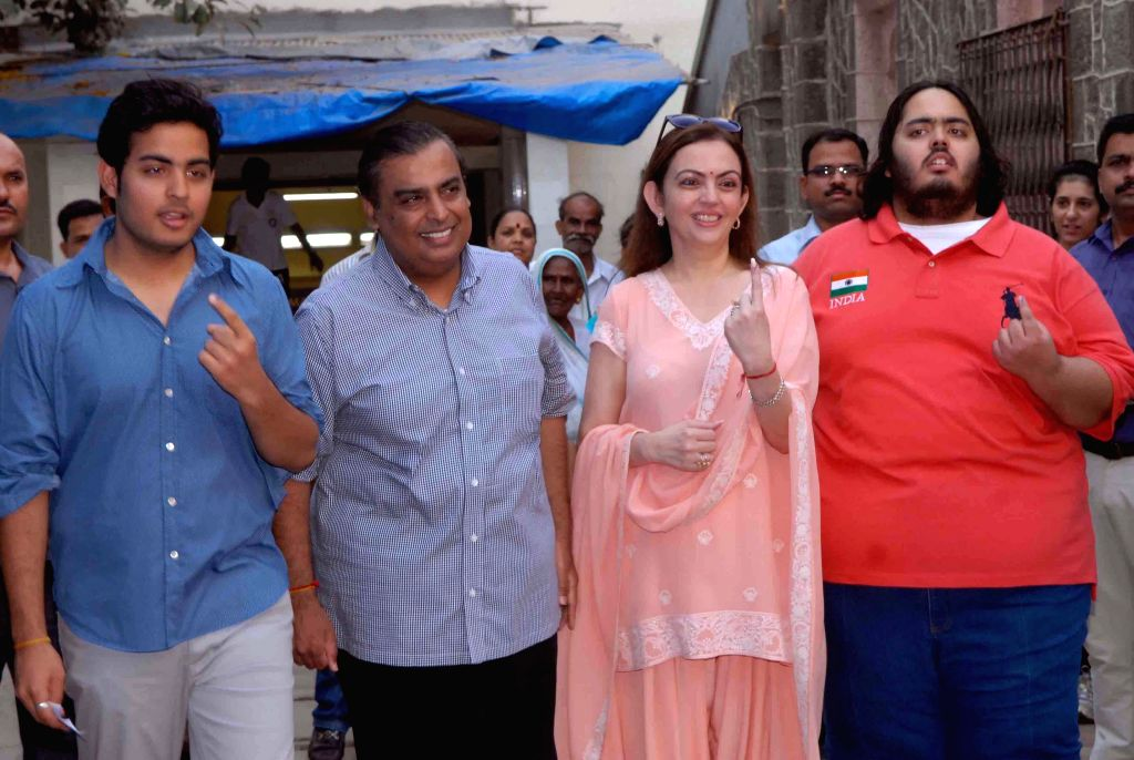 Reliance Industries chairman Mukesh Ambani, and his family members including his wife Nita Ambani show their forefinger marked with phosphorous ink after casting their vote at a polling booth during . - Nita Ambani