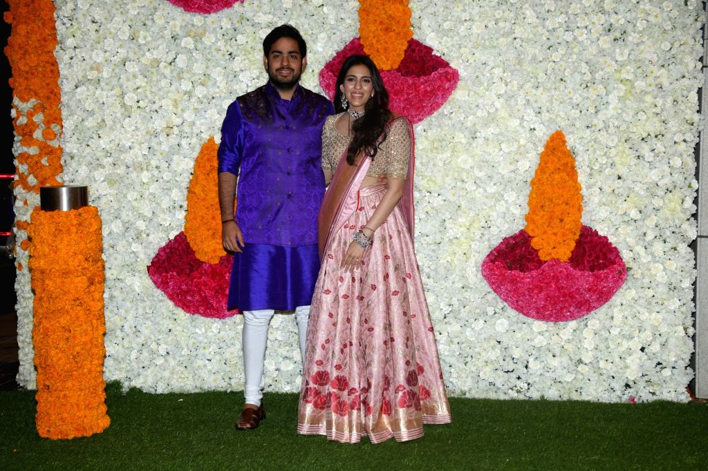 Reliance Industries Chairman Mukesh Ambani's son Akash Ambani with his wife Shloka Mehta at a Diwali bash hosted by his parents in Mumbai on Oct 24, 2019. - Mukesh Ambani, Akash Ambani and Shloka Mehta