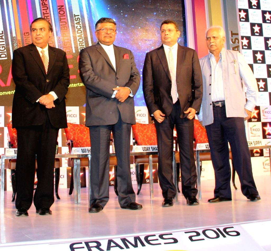 Reliance Industries Chairman Mukesh Ambani, Union Minister for IT and Communications, Star India CEO Uday Shankar and filmmaker Ramesh Sippy during FICCI FRAMES 2016 in Mumbai on March 30, ... - Mukesh Ambani