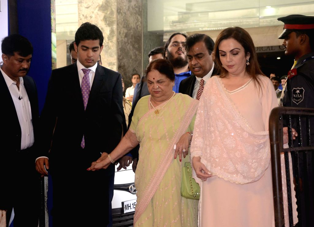 Reliance Industries Limited (RIL) chairman Mukesh Ambani, his wife Nita Ambani, along with their sons Akash, Anant and mother Kokilaben arrive at the company's 40th Annual General Meeting (AGM) held . - Mukesh Ambani and Nita Ambani