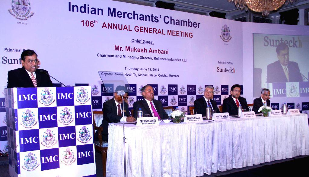 Reliance Industries Ltd (RIL) Chairman and Managing Director Mukesh Ambani addresses during the 106th Annual General Meeting of Indian Merchant Chamber in Mumbai on June 19, 2014. - Mukesh Ambani