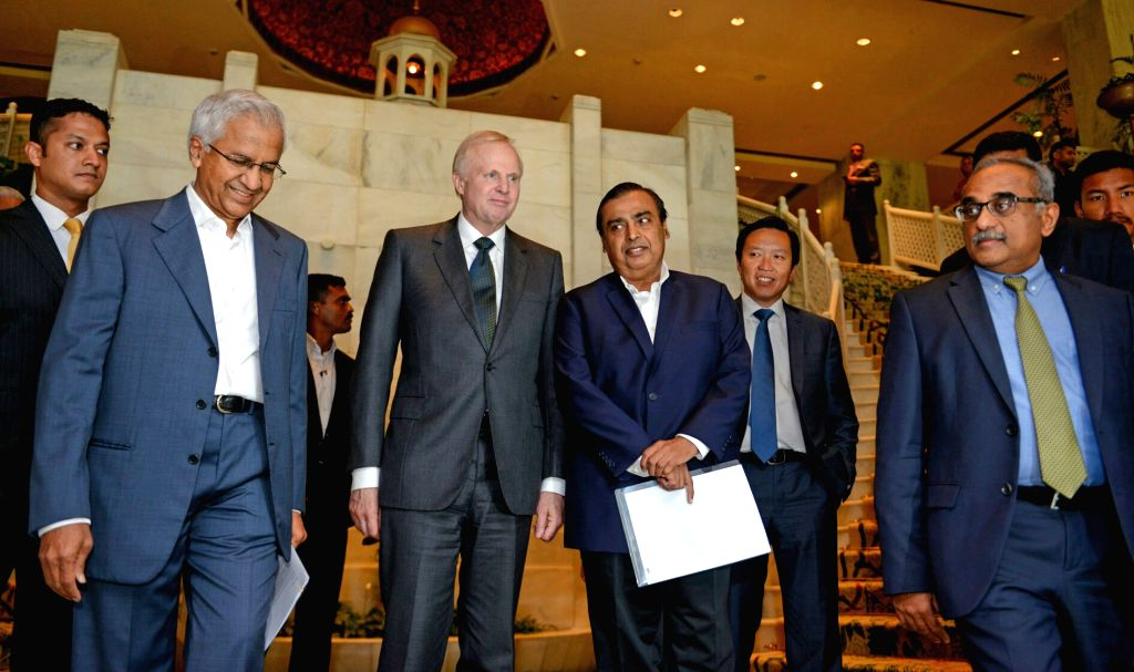 Reliance Industries Ltd (RIL) Chairman Mukesh Ambani and BP Group CEO Bob Dudley arrive for a media interaction in New Delhi on June 15, 2017. - Mukesh Ambani