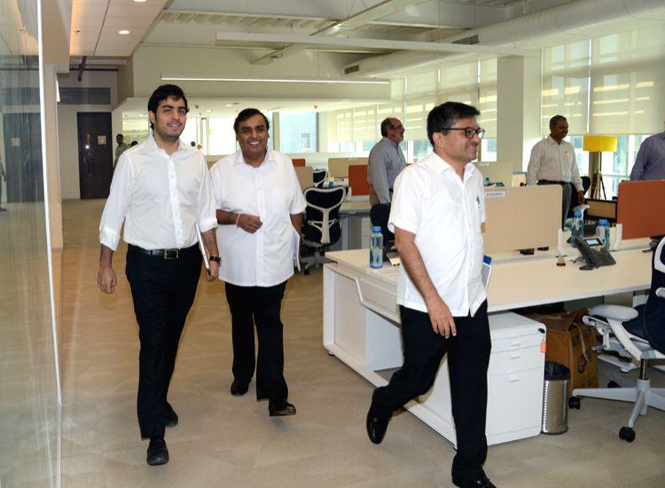 Reliance Industries Ltd (RIL) Chairman Mukesh Ambani with son Akash Ambani and close associate Manoj Modi at Reliance Jio`s `open office` in Mumbai on Nov. 4, 2015.  The open office, which houses  70 ... - Mukesh Ambani, Akash Ambani and Manoj Modi