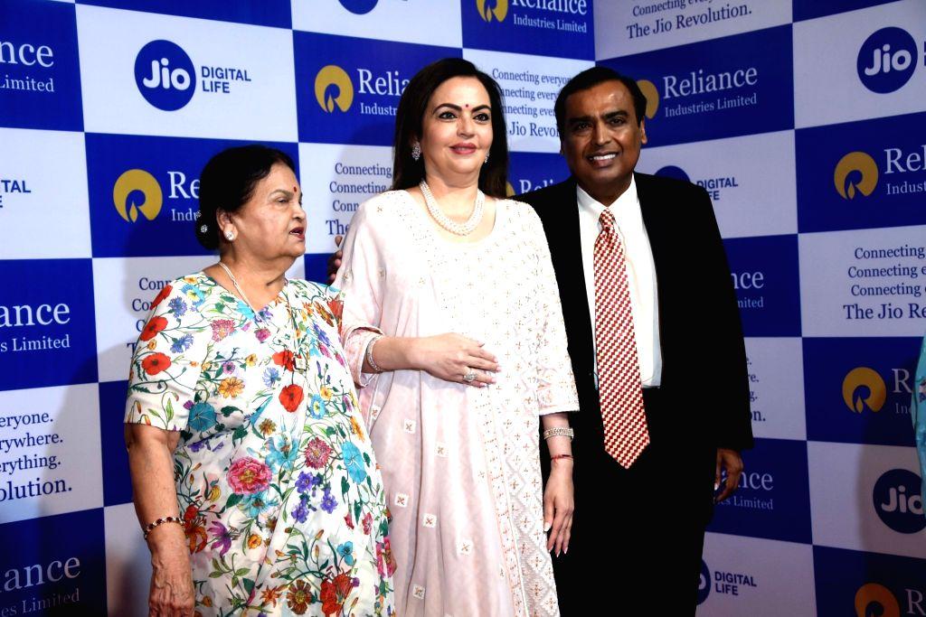 Reliance Industries (RIL) Chairman Mukesh Ambani with his mother Kokilaben Ambani and wife Nita Ambani at RIL's 42nd Annual General Meeting in Mumbai on Aug 12, 2019. - Mukesh Ambani, Kokilaben Ambani and Nita Ambani