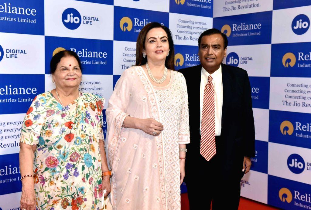 Reliance Industries (RIL) Chairman Mukesh Ambani along with his mother Kokilaben Ambani and wife Nita Ambani at company's 42nd Annual General Meeting in Mumbai on Aug 12, 2019. - Mukesh Ambani, Kokilaben Ambani and Nita Ambani
