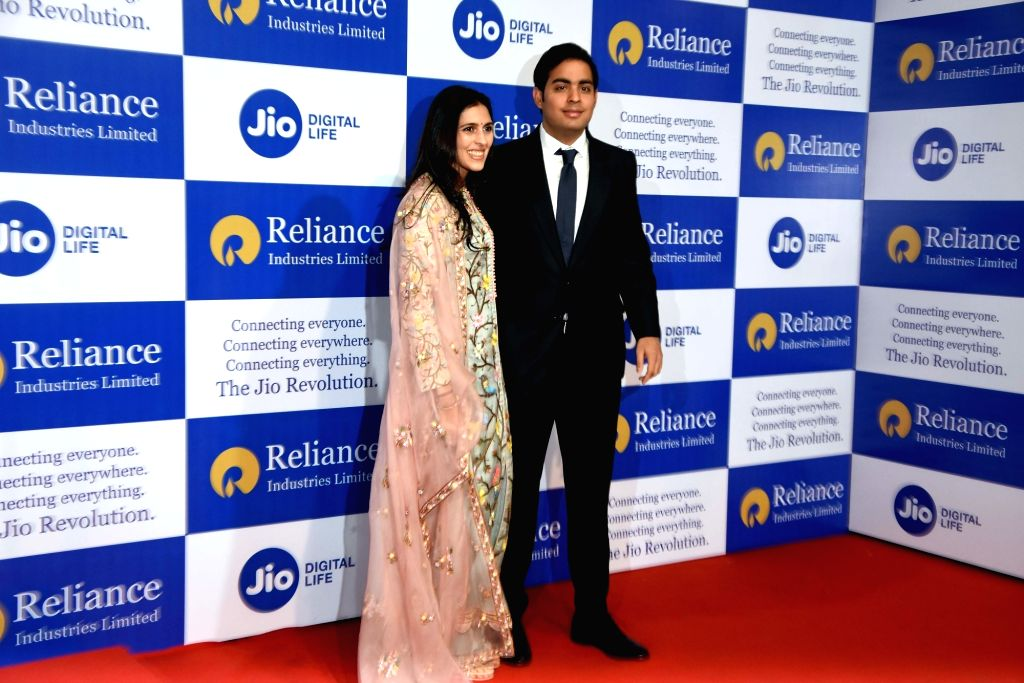 Reliance Industries (RIL) Chairman Mukesh Ambani's son, Akash Ambani with his wife Shloka Mehta at RIL's 42nd Annual General Meeting in Mumbai on Aug 12, 2019. - Mukesh Ambani, Akash Ambani and Shloka Mehta