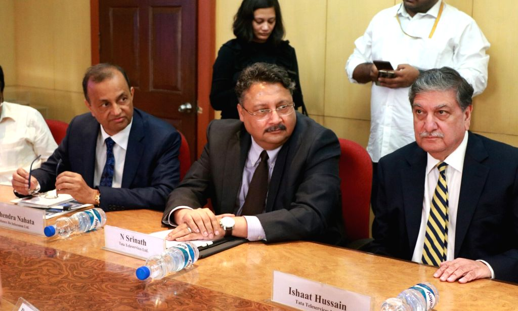 Reliance Jio Infocomm Board Member Mahendra Nahata, Tata Teleservices MD and CEO N Srinath and Tata Sons Director Ishaat Hussain during a metting with telecom players regarding financial ...