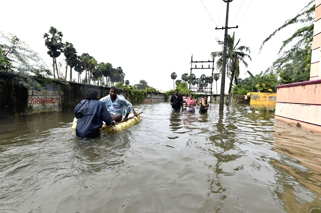 Relief personnel rescue people from water logged areas after fresh rain lashes Chennai on Dec 2, 2015.