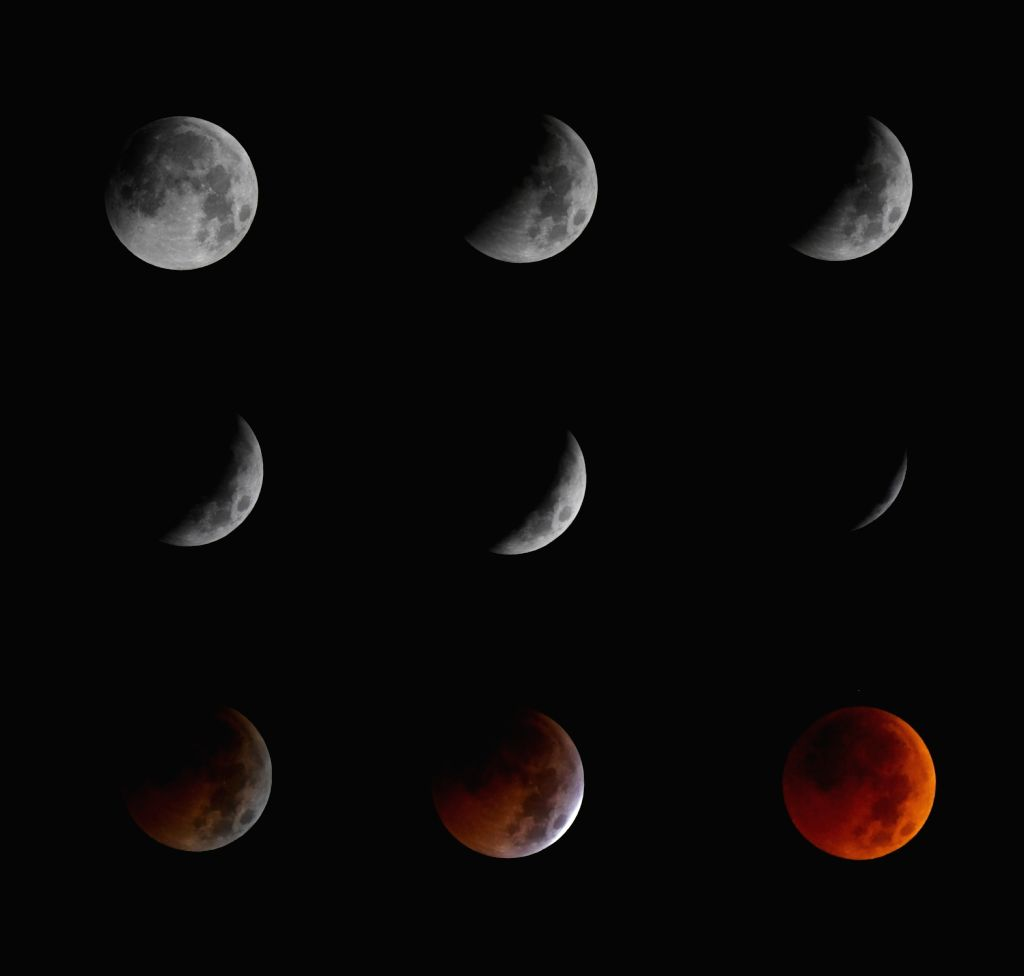 RENHUAI, July 28, 2018 - Combo photo taken on July 28, 2018 shows the stages of a total lunar eclipse in Renhuai City, southwest China's Guizhou Province. It is believed to be the longest lunar ...