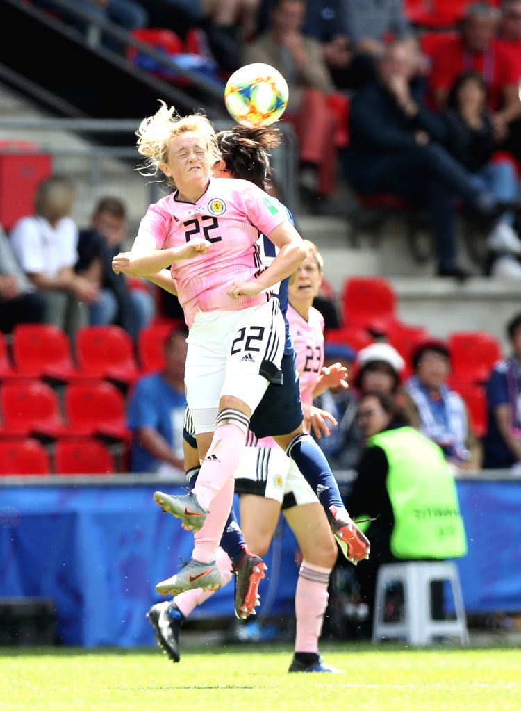 RENNES, June 14, 2019 - Erin Cuthbert (front) of Scotland competes for a header during the group D match between Japan and Scotland at the 2019 FIFA Women's World Cup in Rennes, France, June 14, 2019.