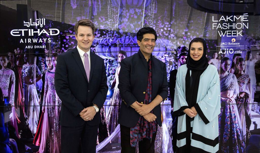 Renowned Indian fashion couturier Manish Malhotra is pictured at Etihad Airways? Innovation Centre in Abu Dhabi, flanked by airline management, Patrick Pierce, Vice President Sponsorships (left), and ... - Manish Malhotra