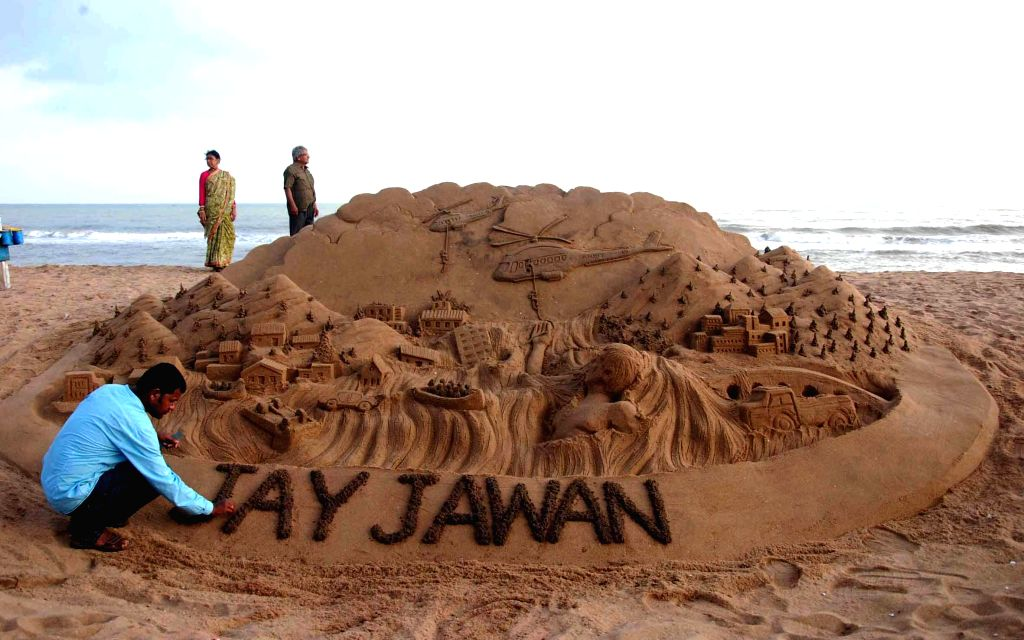 Renowned sand artist Sudarsan Pattnaik pays tribute to the soldiers of the armed forces who are engaged in rescue an relief operations in Jammu and Kashmir floods, through his creation at Puri beach .