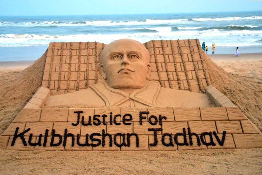 "Renowned sand artist Sudarsan Pattnaik's creation to press for ""Justice for Kulbhushan Jadhav"" in Puri on May 15, 2017. - Sudarsan Pattnai"