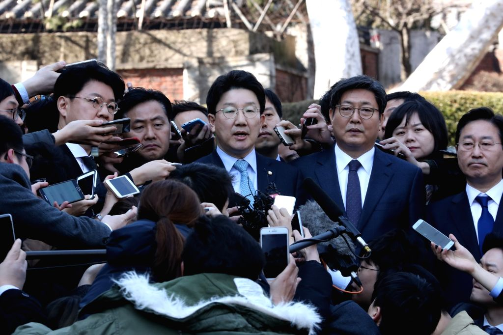 Rep. Kweon Seong-dong, head of the parliamentary committee that led the impeachment proceedings against the president, speaks to the press outside the Constitutional Court in Seoul on March ...