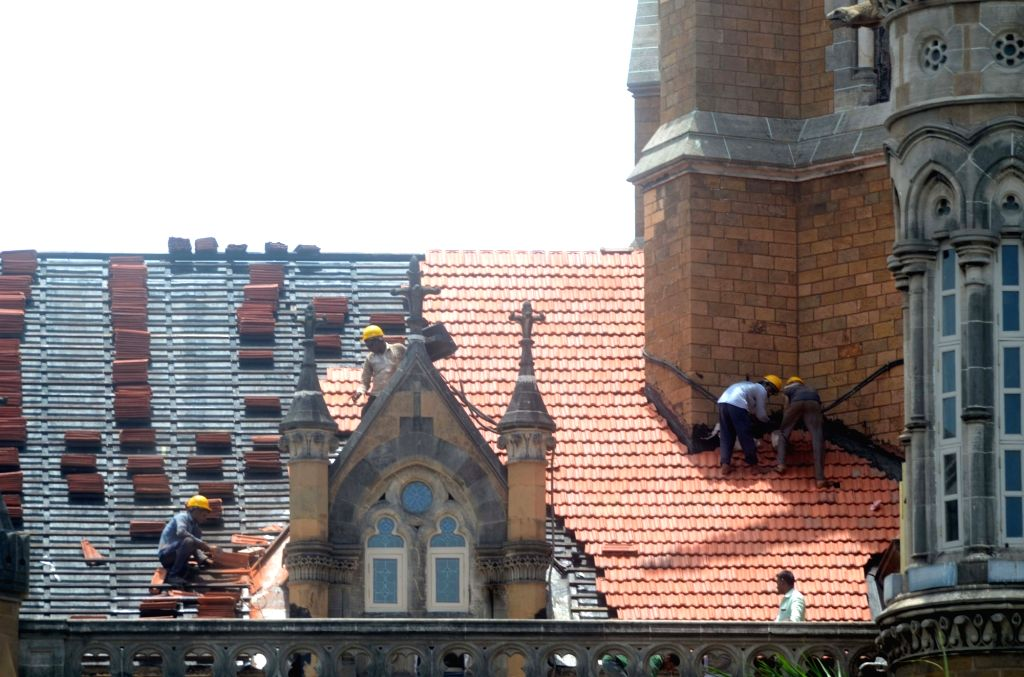 Repair works underway at the rooftop of Chhatrapati Shivaji Maharaj Terminus during the onset of monsoon, in Mumbai on June 13, 2019.