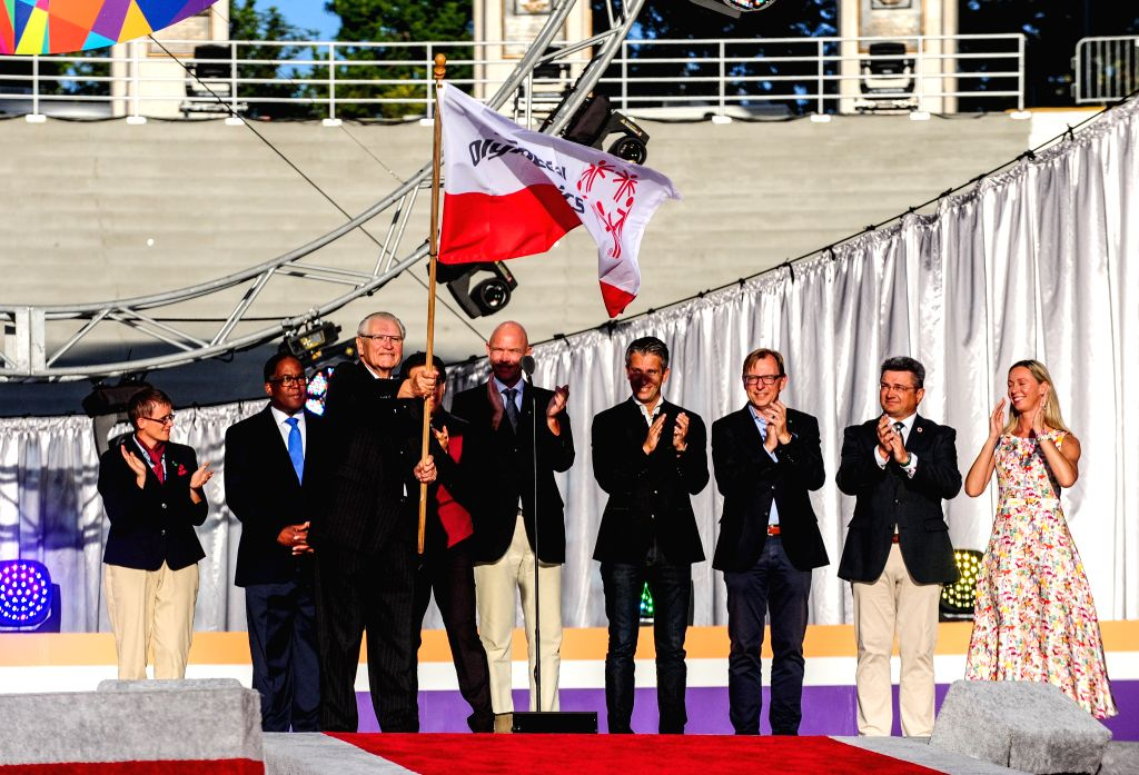 Representatives from Austria, host of next winter Special Olympic Games receive the Speical Olympic flag during the closing ceremony of the Special Olympics ...