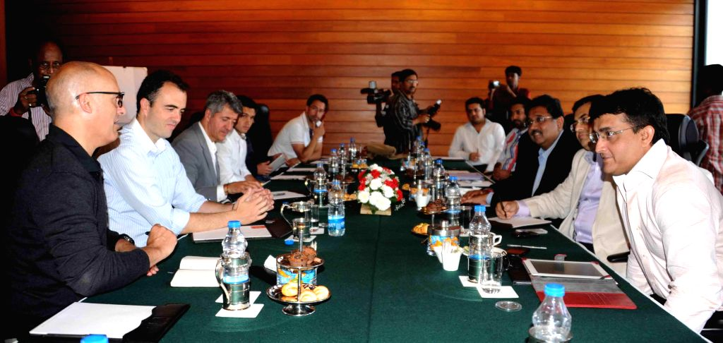 Representatives of Atletico Madrid during an Indian Super Leaugue meeting with former cricketer Sourav Ganguly, Industrialist Harshavardhan Neotia and others in Kolkata on May 6, 2014. - Sourav Ganguly