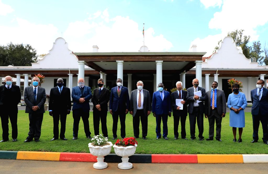 Representatives pose for a group photo after the signing ceremony of compensation agreement at the State House in Harare, Zimbabwe, on July 29, 2020. The Zimbabwean ...