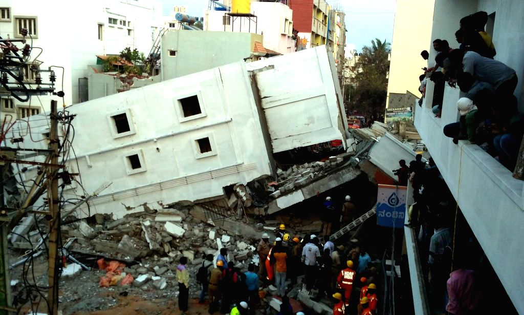 Rescue operation underway after a four-storey building under construction collapsed on Jail Road at Kasavanahalli in Bengaluru on Feb 15, 2018. Reportedly three labourers were killed and ...