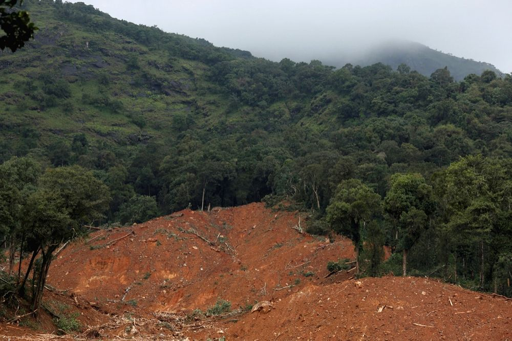 Rescue operation underway after landslide at Thora village in Karnataka's Kodagu district on Aug 11, 2019.