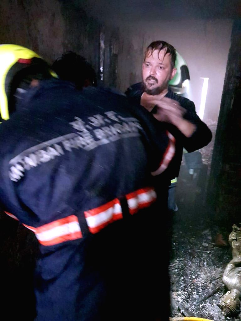Rescue operation underway after one person was killed and one critically injured while 14 others were rescued from a fire that broke out in a four-storeyed building in Mumbai, on 21 July 2019.