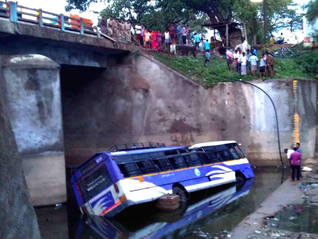 Rescue operation underway at the site where a Telangana State Road Transport Corporation (TSRTC) bus plunged into a canal at Nayakangudem in Telangana on June 24, 2016. Reportedly one ...