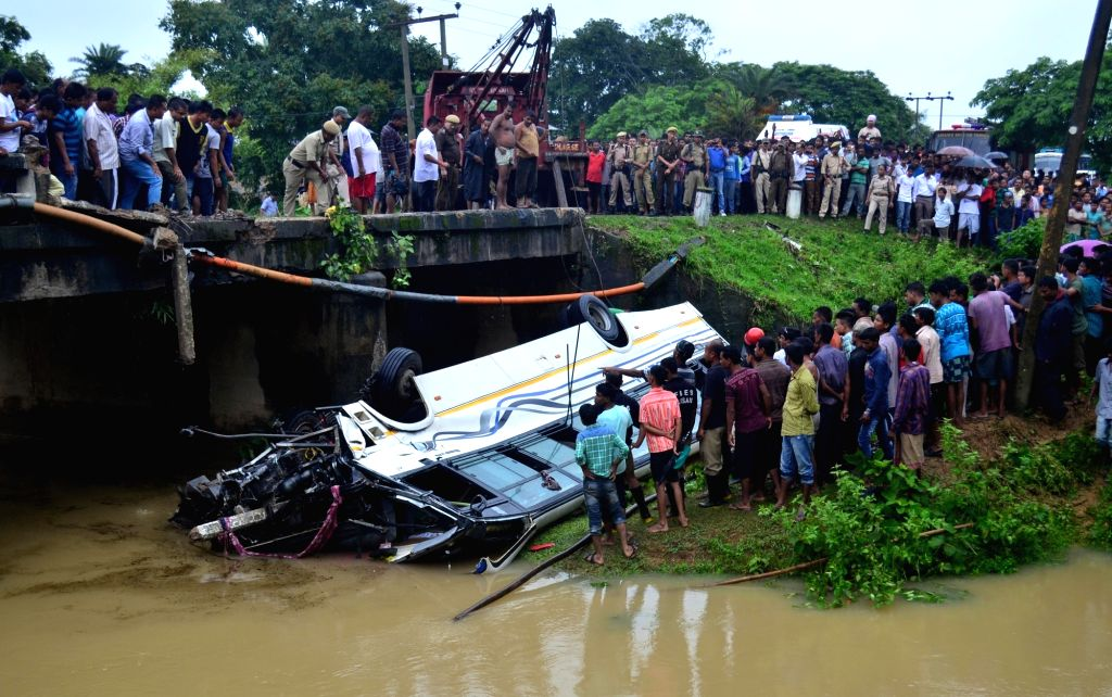Rescue operation underway at the site where a passenger bus fell off a bridge at Sakhati in Kamrup district of Assam on July 5, 2016. Reportedly four people were killed and 24 others injured.