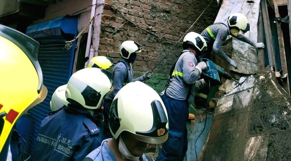 Rescue operation underway by Mumbai fire brigade and NDRF after a three-storied tenement (chawl) caved in at Deepjyoti Chawl, Laljipada in Kandivali West, Mumbai. At least 12 persons were ...