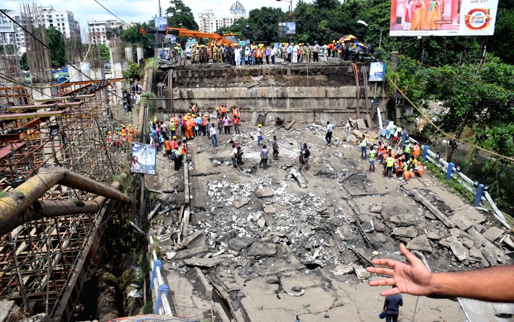 Rescue operations underway after a portion of the 40-year-old Majerhat Bridge collapsed a day earlier; on Sept 5, 2018. A part of the bridge between Taratala and Mominpur collapsed around ...
