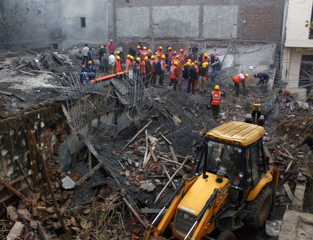 Rescue operations underway after an under-construction four storey building collapsed, trapping at least seven people in Gurugram, on Jan 24, 2019.