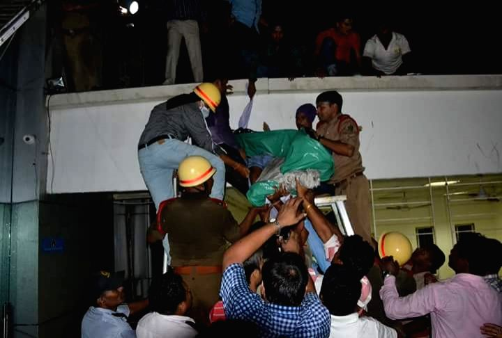 Rescue operations underway at Institute of Medical Sciences and SUM Hospital where a fire broke out killing 22 people in Bhubaneswar on Oct 20, 2016.