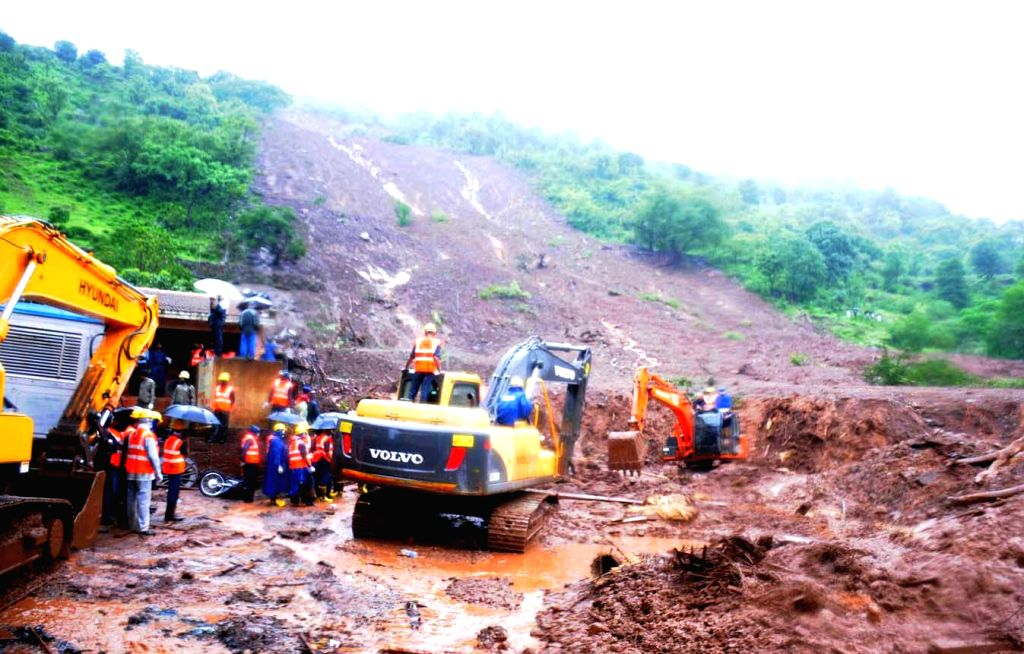 Rescue operations underway at Malin village, near Pune which was buried in a landslide, killing at least 25 people and trapping more than 160 on early Wednesday (30th July, 2014) morning; on July 31,